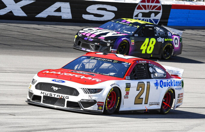 Drivers Jimmie Johnson (48) and Paul Menard (21) race down the front stretch during a NASCAR Cup auto race at Texas Motor Speedway, Sunday, March 31, 2019, in Fort Worth, Texas. (AP Photo/Larry Papke)