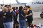 Relatives of Ukrainian prisoners freed by Russia greet them upon their arrival at Boryspil airport, outside Kyiv, Ukraine, Saturday, Sept. 7, 2019. Planes carrying prisoners freed by Russia and Ukraine have landed in the countries' capitals, in an exchange that could be a significant step toward improving relations between Moscow and Kyiv. The planes, each reportedly carrying 35 prisoners, landed almost simultaneously at Vnukovo airport in Moscow and at Kyiv's Boryspil airport. (AP Photo/Efrem Lukatsky)