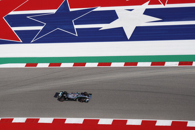 File-This Nov. 1, 2019, file photo shows Mercedes' Lewis Hamilton, of Britain, driving during the second practice session for the Formula One U.S. Grand Prix auto race at Circuit of the Americas in Austin, Texas. NASCAR wanted new energy and ideas this season and Marcus Smith has been pivotal in helping the sport deliver. The head of Speedway Motorsports dumped dirt all over Bristol Motor Speedway earlier this season and now guides NASCAR into a new market with this weekend's triple-header at Circuit of the Americas in Austin. (AP Photo/Chuck Burton, File)