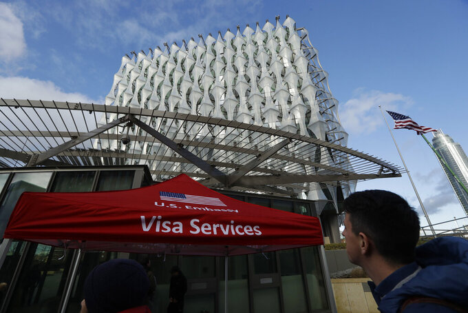 FILE - In this Jan. 16, 2018 file photo, a Visa Services gazebo stands outside the U.S. Embassy in London as visa applicants wait to go inside. A youth soccer club hoping to welcome its new coach from the United Kingdom to Louisiana says it has been caught up in a bureaucratic quagmire for more than a year. The recently filed federal lawsuit that involves a presidential order aimed at curbing travel to stop the spread of COVID-19 names the U.S. Department of State and the U.S. embassy in London as defendants. (AP Photo/Matt Dunham, File)