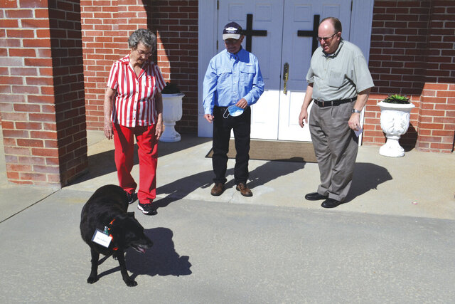 Standing outside Terry's Creek Baptist Church, Magnolia, Miss., with Spike are, from left, Catherine Brown, Tom Gunther and the Rev. Laverne Summerlin on June 18, 2020. (Ernest Herndon/The Enterprise-Journal via AP)