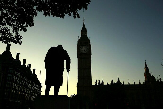 FILE - In this Friday, June 24, 2016 file photo file photo a statue of Winston Churchill is silhouetted against the Houses of Parliament and the early morning sky in London, Friday, June 24, 2016. Britain's love-hate relationship with the rest of Europe goes back decades, but the Brexit crisis gripping it today stems from dramatic January 2013 speech by Prime Minister David Cameron in which he promised an