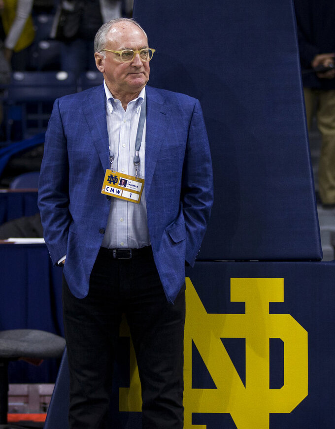 "FILE - In this Feb. 28, 2018, file photo, Notre Dame athletic director Jack Swarbrick stands under a basket following an NCAA college basketball game against Pittsburgh, in South Bend, Ind. Army vs Notre Dame football at Yankee Stadium is part of Notre Dame's Shamrock Series, an almost annual off-site home game the Fighting Irish have played since 2009. It's a nod to Notre Dame's history of adventurous independence and the vision Jesse Harper, the coach of Notre Dame's first great teams, had for turning a small Catholic school in the Midwest into a national powerhouse. ""It's born of that, but I think it has current value,"" Notre Dame athletic director Jack Swarbrick said.  (AP Photo/Robert Franklin, File)"