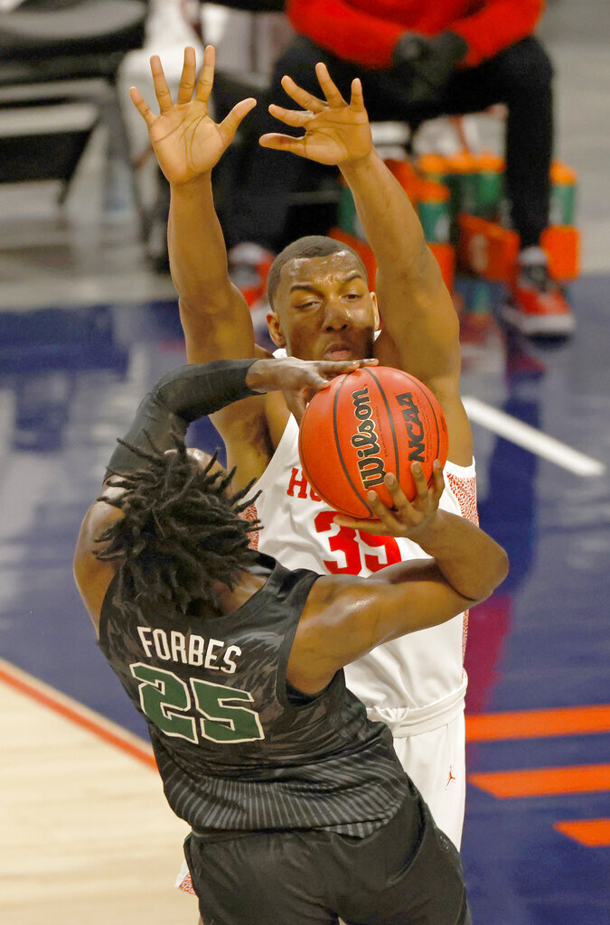 Tulane guard Jaylen Forbes (25) goes up to shoot as Houston forward Fabian White Jr. (35) defends the basket during the first half of an NCAA college basketball game in the quarterfinal round of the American Athletic Conference men's tournament Friday, March 12, 2021, in Fort Worth, Texas. (AP Photo/Ron Jenkins)