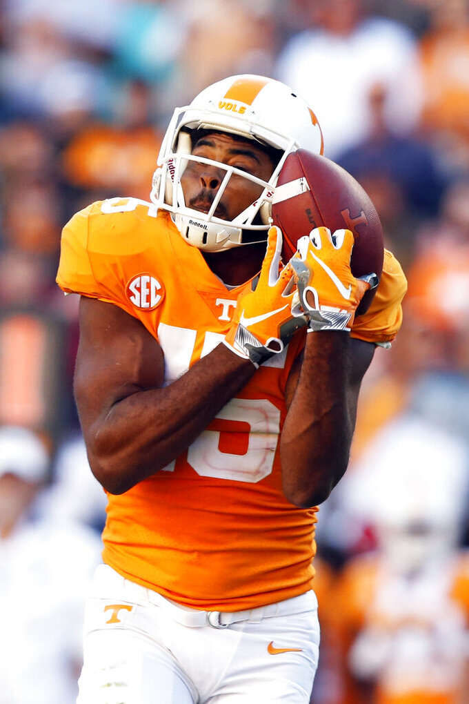FILE - In this Oct. 20, 2018, file photo, Tennessee wide receiver Jauan Jennings (15) catches a pass against Alabama in the first half of an NCAA college football game in Knoxville, Tenn. Tennessee's wide receivers savor the opportunity to play for their new position coach because they appreciate what Tee Martin accomplished during his own playing career. Martin was the starting quarterback on Tennessee's 1998 national championship team and is back at his alma mater trying to help the Volunteers become competitive again in the Southeastern Conference.(AP Photo/Wade Payne, File)