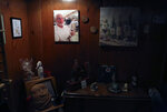 A portrait of the late John Walter wearing a red clown nose hangs in the basement of his family's home in the Queens borough of New York, Tuesday, March 30, 2021. Walter died of the coronavirus at Mount Sinai Hospital on May 10, 2020. (AP Photo/Jessie Wardarski)