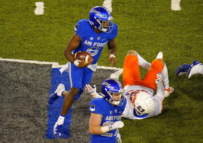 Air Force quarterback Warren Bryan, left, runs for a short gain past Boise State defensive end Sam Whitney in the second half of an NCAA college football game Saturday Oct. 31 2020, at Air Force Academy, Colo. (AP Photo/David Zalubowski)