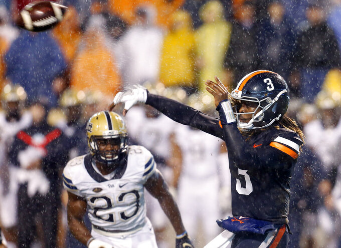 Virginia quarterback Bryce Perkins (3) throws a pass during the first half against Pittsburgh in an NCAA college football game in Charlottesville, Va., Friday, Nov. 2, 2018. (AP Photo/Steve Helber)