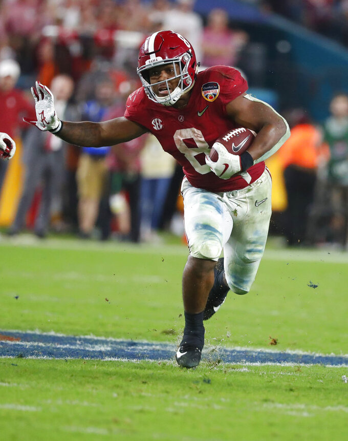 FILE-This Dec. 30, 2018,  file photo shows Alabama running back Josh Jacobs (8) running the ball, during the second half of the Orange Bowl NCAA college football game in Miami Gardens, Fla. Jacobs won the MVP in the SEC title game win over Georgia after rushing for 83 yards and two touchdowns. (AP Photo/Wilfredo Lee,File)