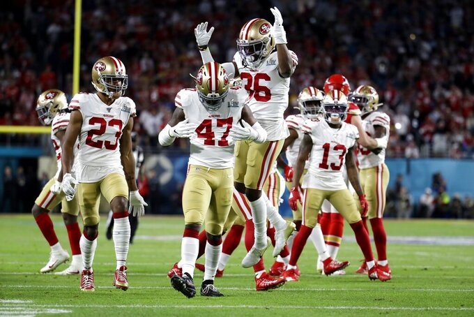 San Francisco 49ers' Elijah Lee (47) celebrates with Ahkello Witherspoon (23) and Marcell Harris during the first half of the NFL Super Bowl 54 football game against the Kansas City Chiefs, Sunday, Feb. 2, 2020, in Miami Gardens, Fla. (AP Photo/Lynne Sladky)