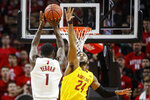 Rutgers' Akwasi Yeboah (1) shoots as Maryland's Donta Scott (24) defends during the first half of an NCAA college basketball game Tuesday, March 3, 2020, in Piscataway, N.J. (AP Photo/John Minchillo)
