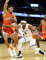 Buffalo's CJ Massinburg (5) drives past Bowling Green's Demajeo Wiggins (1) during the first half of an NCAA college basketball championship game of the Mid-American Conference men's tournament, Saturday, March 16, 2019, in Cleveland. (AP Photo/Tony Dejak)