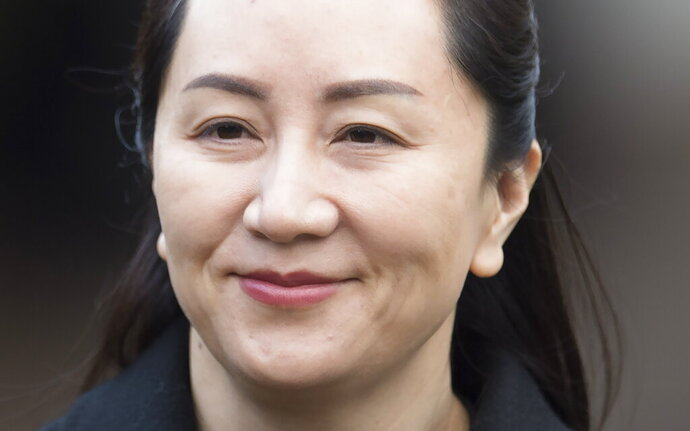 Meng Wanzhou, chief financial officer of Huawei, leaves her home to go to B.C. Supreme Court in Vancouver, Tuesday, Jan. 21, 2020. Wanzhou is in court for hearings over an American request to extradite the executive of the Chinese telecom giant Huawei on fraud charges. (Jonathan Hayward/The Canadian Press via AP)