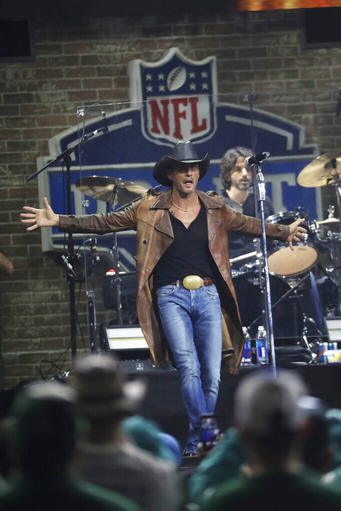 Country music star Tim McGraw performs after the NFL football draft, Friday, April 26, 2019, in Nashville, Tenn. (AP Photo/Mark Humphrey)