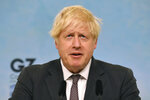 Britain's Prime Minister Boris Johnson speaks, during a press conference on the final day of the G7 summit in Carbis Bay, Cornwall, England, Sunday June 13, 2021. (Ben Stansall/Pool Photo via AP)