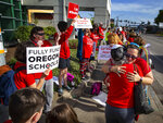 Teachers and supporters gather at the intersection of 29th Ave. and Willamette St. in Eugene, Ore, Wednesday, May 8, 2019, during a walkout in support of more funding for education in Oregon. (Chris Pietsch/The Register-Guard via AP)