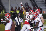 Georgia wide receiver Arian Smith (11) celebrates a touchdown against South Carolina with Darnell Washington (0), Ben Cleveland (74) and Kearis Jackson (10) during the second half of an NCAA college football game Saturday, Nov. 28, 2020, in Columbia, S.C. Georgia won 45-16. (AP Photo/Sean Rayford)
