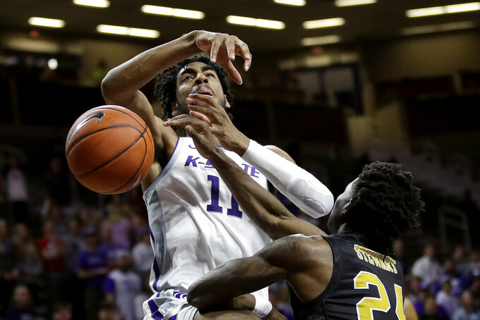 Alabama State's Kevion Stewart knocks the ball away from Kansas State's Antonio Gordon (11) during the second half of an NCAA college basketball game Wednesday, Dec. 11, 2019, in Manhattan, Kan. (AP Photo/Charlie Riedel)