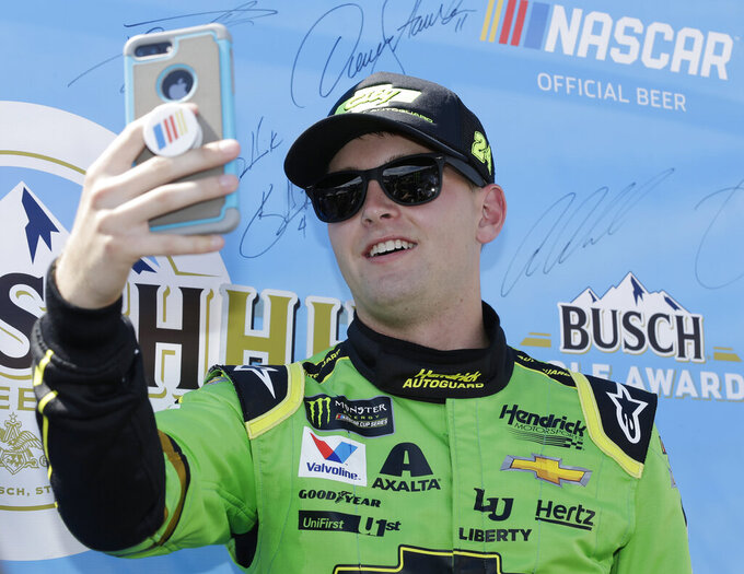 William Byron takes a selfie after qualifying on the pole for the NASCAR Cup series auto race on Saturday, Aug. 31, 2019, at Darlington Raceway in Darlington, S.C.. (AP Photo/Terry Renna)