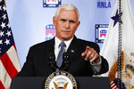 FILE - In this Aug. 24, 2018 file photo, Vice President Mike Pence gestures while speaking to the Republican National Lawyers Association in Washington. President Donald Trump is lashing out against the anonymous senior official who wrote an opinion piece in The New York Times.  Washington is consumed by a wild guessing game as to the identity of the writer, and swift denials of involvement in the op-ed came Thursday from top administration officials, including from Vice President Mike Pence's office, Secretary of State Mike Pompeo and Dan Coats, director of national intelligence, and other Cabinet members.  (AP Photo/Jacquelyn Martin)