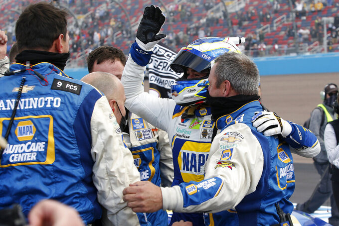 Chase Elliott, center, celebrates with his pit crew following his season championship victory in an NASCAR Cup Series auto race at Phoenix Raceway, Sunday, Nov. 8, 2020, in Avondale, Ariz. (AP Photo/Ralph Freso)