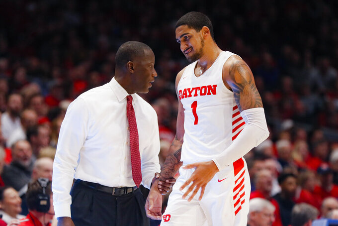 Dayton head coach Anthony Grant, left, speaks with Obi Toppin (1) during the second half of an NCAA college basketball game against Drake, Saturday, Dec. 14, 2019, in Dayton, Ohio. (AP Photo/John Minchillo)