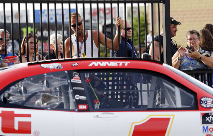 NASCAR fans watch Michael Annett's car during the final NASCAR Xfinity Series auto race practice at Chicagoland Speedway in Joliet, Ill., Friday, June 28, 2019. (AP Photo/Nam Y. Huh)