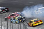 Christopher Bell (20) spins coming out of Turn 2 in front of Austin Dillon (3) and Joey Logano (20) during the NASCAR Cup Series All-Star auto race at Texas Motor Speedway in Fort Worth, Texas, Sunday, June 13, 2021. (AP Photo/Larry Papke)