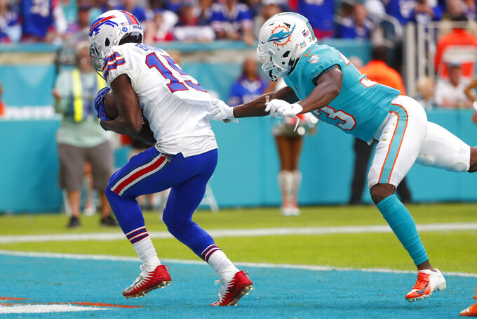 Buffalo Bills wide receiver John Brown (15) scores a touchdown as Miami Dolphins cornerback Jomal Wiltz (33) is late with the tackle, during the second half at an NFL football game, Sunday, Nov. 17, 2019, in Miami Gardens, Fla. (AP Photo/Wilfredo Lee)