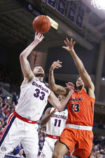 Gonzaga forward Killian Tillie (33) and Pacific forward Jeremiah Bailey (13) go after a rebound during the first half of an NCAA college basketball game in Spokane, Wash., Saturday, Jan. 25, 2020. (AP Photo/Young Kwak)