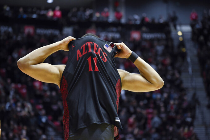 San Diego State forward Matt Mitchell (11) reacts after missing the final basket during the second half of an NCAA college basketball game against UNLV, Saturday, Feb. 22, 2020, in San Diego. (AP Photo/Denis Poroy)