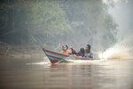 Villagers ride a boat on a river near a forest blanketed by haze from forest fires near Kaja Island, Central Kalimantan, Indonesia, Thursday, Sept. 19, 2019. Indonesia's fires are an annual problem that strains relations with neighboring countries. The smoke from the fires has blanketed parts of Indonesia, Singapore, Malaysia and southern Thailand in a noxious haze. (AP Photo/Fauzy Chaniago)