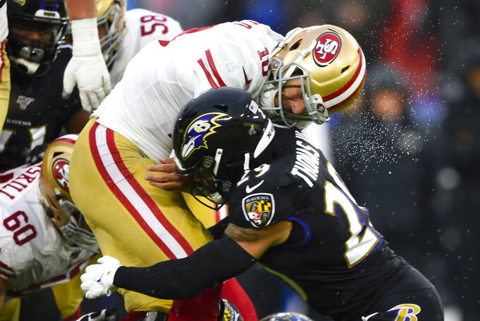 San Francisco 49ers quarterback Jimmy Garoppolo (10) is tackled by Baltimore Ravens free safety Earl Thomas (29) in the first half of an NFL football game, Sunday, Dec. 1, 2019, in Baltimore, Md. (AP Photo/Gail Burton)