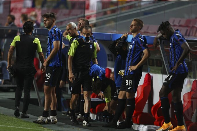Atalanta players react during the Champions League quarter-final soccer match between Atalanta and Paris Saint-Germain, at the Luz stadium in Lisbon, Portugal, Wednesday, Aug. 12, 2020. PSG won 2-1. (Rafael Marchante/Pool via AP)