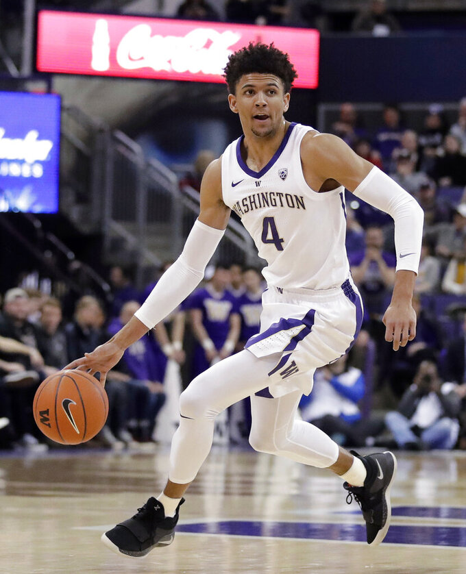 FILE - In this March 6, 2019, file photo, Washington guard Matisse Thybulle (4) drives against Oregon State during the first half of an NCAA college basketball game, in Seattle. Thybulle was named Player of the Year in the Pac-12, Tuesday, March 12, 2019. (AP Photo/Ted S. Warren, File)