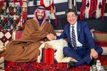 """FILE - In this Sunday, Jan. 12, 2020 file photo, released by Saudi Press Agency, Japan's Prime Minister Shinzo Abe, right, wearing a traditional Saudi robe, shakes hands with Saudi Crown Prince Mohammed bin Salman inside a tent in the northwestern desert region of Al-Ula, north of Medina, Saudi Arabia. A flurry of diplomatic visits and meetings crisscrossing the Persian Gulf are driving urgent efforts to defuse the possibility of all-out war after the U.S. killed Iran's top military commander. Global leaders and top diplomats are repeating in recent days the mantra of """"de-escalation"""" and """"dialogue,"""" yet none have publicly laid out a path to achieving either. (Saudi Press Agency via AP)"""