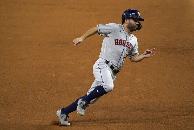 Houston Astros' Jose Altuve rounds third on his way home, scoring on a Yuli Gurriel single in the eighth inning of a baseball game against the Texas Rangers in Arlington, Texas, Friday, Sept. 25, 2020. (AP Photo/Tony Gutierrez)