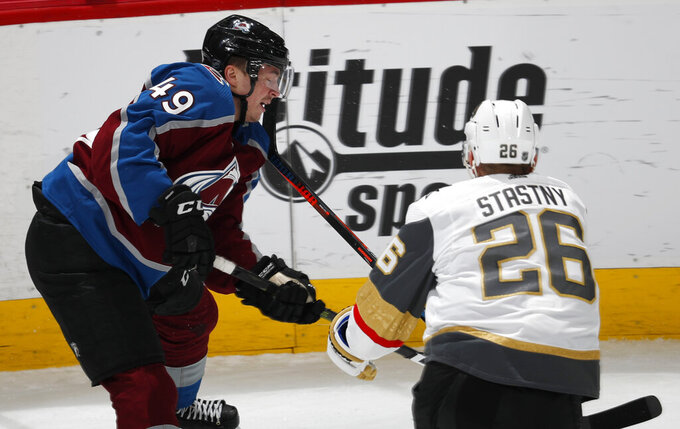 Vegas Golden Knights center Paul Stastny, right, defends against Colorado Avalanche defenseman Samuel Girard during the first period of an NHL hockey game Wednesday, March 27, 2019, in Denver. Stastny was called for high-sticking. (AP Photo/David Zalubowski)