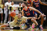 Purdue guard Sasha Stefanovic (55) is fouled by Virginia forward Jay Huff (30) during the first half of an NCAA college basketball game in West Lafayette, Ind., Wednesday, Dec. 4, 2019. (AP Photo/Michael Conroy)