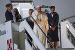Pope Francis waves as he boards an airplane to Thailand, at the Rome Leonardo da Vinci airport, Tuesday, Nov. 19, 2019. Pope Francis' three-day visit to Thailand, followed by three days in Japan, will be a welcome break for the 82-year-old pope. He is enduring fresh opposition from Catholic conservatives in the U.S. over his just-concluded meeting on the Amazon as well as a new financial scandal at home. (AP Photo/Alessandra Tarantino)