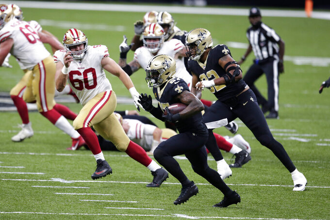 New Orleans Saints strong safety Malcolm Jenkins (27) returns an interception in the second half of an NFL football game against the San Francisco 49ers in New Orleans, Sunday, Nov. 15, 2020. (AP Photo/Butch Dill)