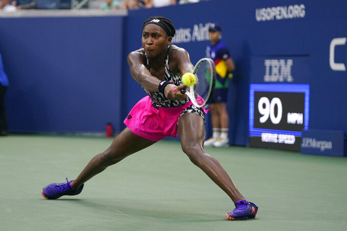 Cori Gauff, of the United States, returns a shot against Magda Linette, of Poland, during the first round of the US Open tennis championships, Monday, Aug. 30, 2021, in New York. (AP Photo/Frank Franklin II)