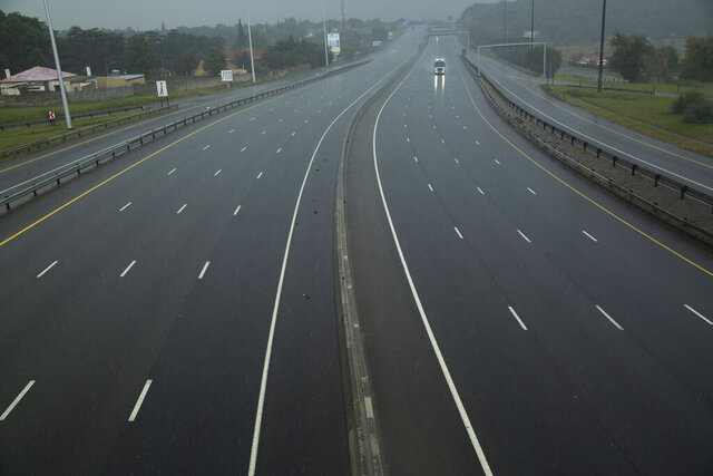 A car drives along a motorway in Johannesburg, South Africa, Saturday, April 4, 2020. South Africa went into a nationwide lockdown for 21 days in an effort to control the spread of the coronavirus. The new coronavirus causes mild or moderate symptoms for most people, but for some, especially older adults and people with existing health problems, it can cause more severe illness or death. (AP Photo/Themba Hadebe)