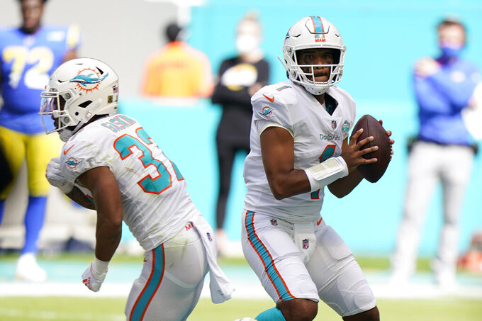 Miami Dolphins quarterback Tua Tagovailoa (1) looks to throw his first complete pass during the first half of an NFL football game against the Los Angeles Rams, Sunday, Nov. 1, 2020, in Miami Gardens, Fla. (AP Photo/Wilfredo Lee)