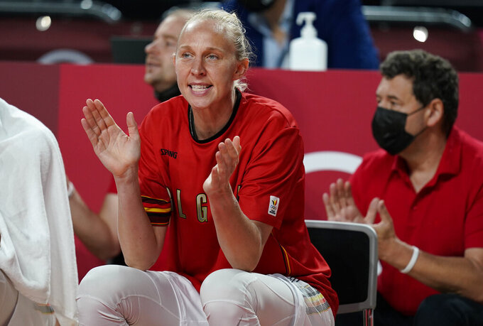 Belgium's Ann Wauters (12) cheers for her teammates as she sits on the bench during women's basketball preliminary round game between Belgium and Puerto Rico at the 2020 Summer Olympics, Friday, July 30, 2021, in Saitama, Japan. (AP Photo/Charlie Neibergall)