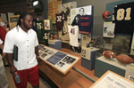 FILE - In this June 30, 2012, file photo, Cleveland Browns running back Trent Richardson tours the Pro Football Hall of Fame in Canton, Ohio.The Pro Football Hall of Fame will reopen Wednesday, June 10, 2020, after nearly a three-month hiatus due to the coronavirus pandemic. (AP Photo/Tony Dejak, File)