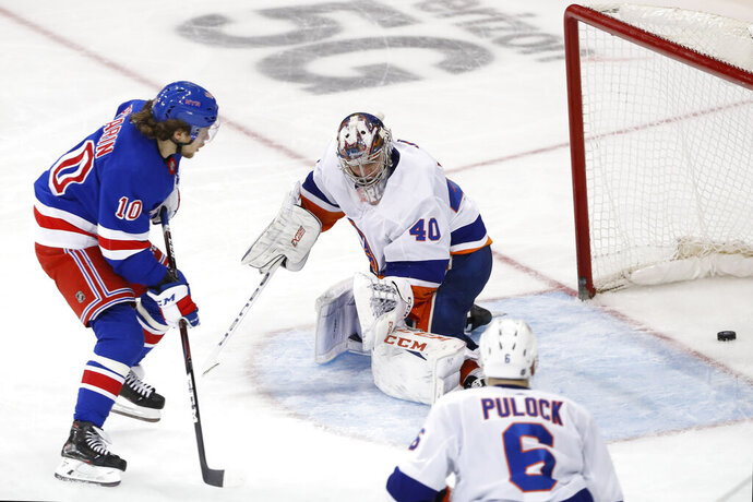 CORRECTS FINAL SCORE TO 6-2 NOT 6-1 New York Rangers left wing Artemi Panarin (10) watches his goal slide past New York Islanders goaltender Semyon Varlamov (40) during the third period of an NHL hockey game, Monday, Jan. 13, 2020, in New York. Panarin had two goals in the Rangers 6-2 victory over the Islanders. Islanders defenseman Ryan Pulock (6) watches. (AP Photo/Kathy Willens)