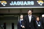 FILE - In this Oct. 28, 2018, file photo, Jacksonville Jaguars owner Shahid Khan arrives to watch the warm-up before an NFL football game against Philadelphia Eagles at Wembley stadium in London. Backed by billionaire Jacksonville Jaguars owner Shahid Khan and his son Tony, new promotion All Elite Wrestling is set to make its debut on Wednesday, Oct. 2, 2019, on TNT. The company wants to give WWE a run for its money and has already signed big stars Chris Jericho and Cody Rhodes to make an instant splash. (AP Photo/Tim Ireland, File)