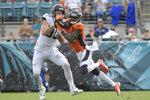 Denver Broncos safety Kareem Jackson, right, intercepts a pass in front of Jacksonville Jaguars tight end Luke Farrell during the second half of an NFL football game, Sunday, Sept. 19, 2021, in Jacksonville, Fla. (AP Photo/Phelan M. Ebenhack)