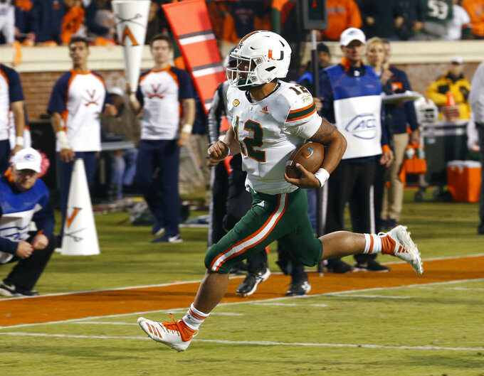 Miami quarterback Malik Rosier (12) runs in for a touchdown during the second half of an NCAA college football game in Charlottesville, Va., Saturday, Oct. 13, 2018. Virginia defeated Miami 16-13. (AP Photo/Steve Helber)